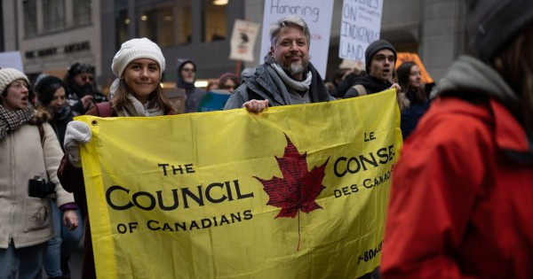 Activists with holding the Council of Canadians banner