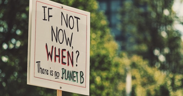 "a sign that says ""If not now, when? There is no Planet B."""